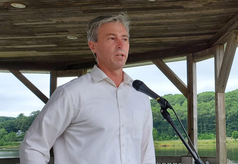 Tim Houston addresses crowd at Shipyards Landing, Bridgewater. he stands In front of a microphone