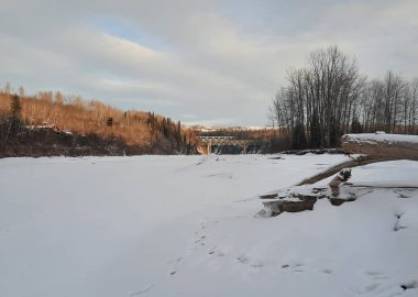 A snow covered Peace River near the Site C dam on a sunny day