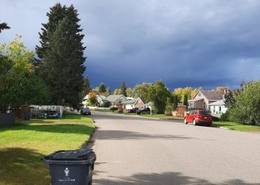 A residential street in Prince George with dramatic clouds in the sky.