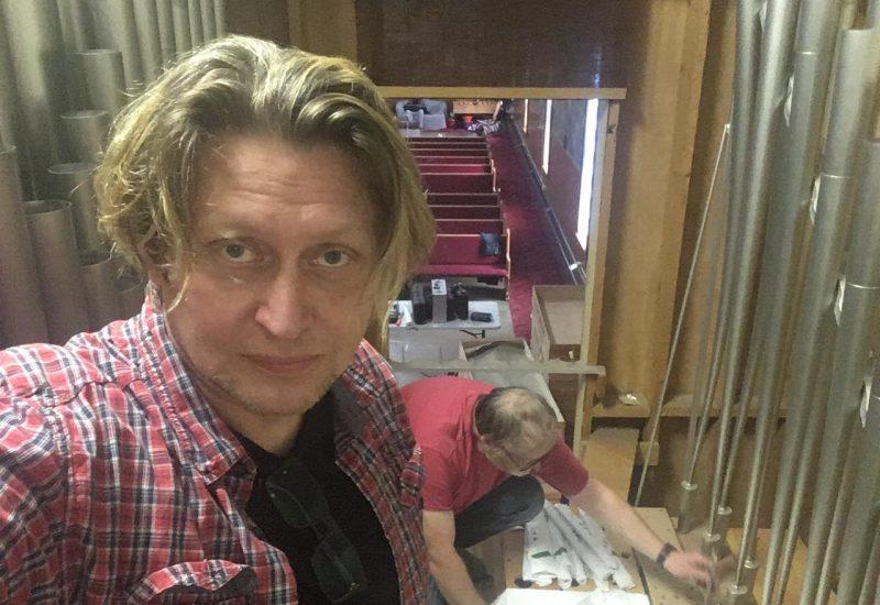 Xaver Varnus looks on as his pipe organ is taken apart before transport