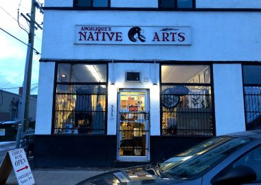 Angelique's Native Arts storefront at dusk.