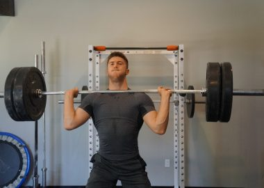 Mansfield resident Xavier Lusignan lifting weights at his home