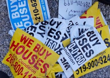 A pile of stickers and signs with