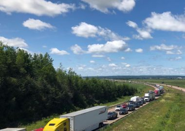 Traffic waits to cross into Nova Scotia on day one of the Atlantic Bubble, July 3, 2020. Photo: James Anderson.