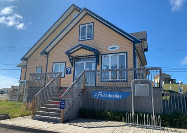 A photo of the outside of the Tourism Information Center on the Magdalen Islands