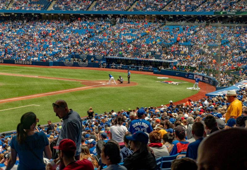 Crowd of people inside a baseball stadium.