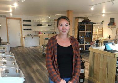 A photo of Emilie Schmidt standing in her business Rejar Zero Waste.