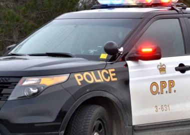 A close up of the front of an OPP black and white vehicle.
