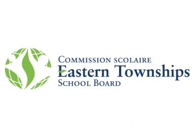 The official logo of the Eastern Townships School Board