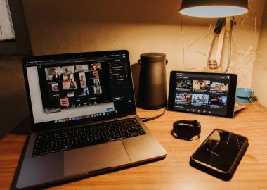 A desk with video conference on laptop screen