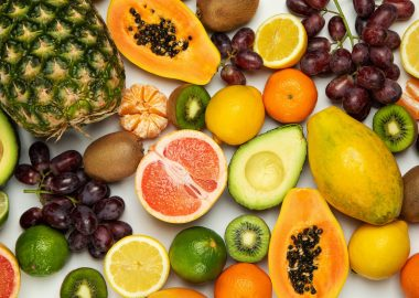 A photo with various fruits on a white background.