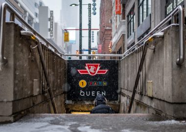 Photo of the underground entrance leading to Queen subway station in Toronto.