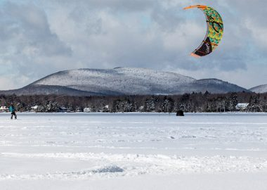 Kite skier on snowy brome lake