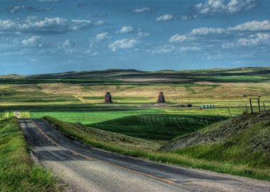 A photo of a sunny road in the Canadian prairies.