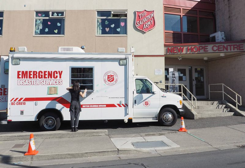 A picture of a white truck with a take out window outside of the Salvation Army in Nanaimo.
