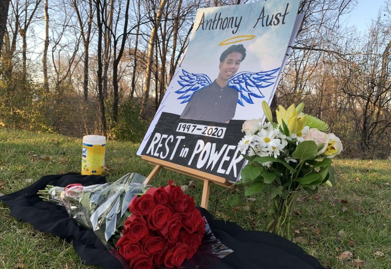 A photo of a sign commemorating Anthony Aust at an outdoor vigil on Nov. 8.