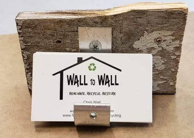 Wall to Wall business cards in an upcycled stand.